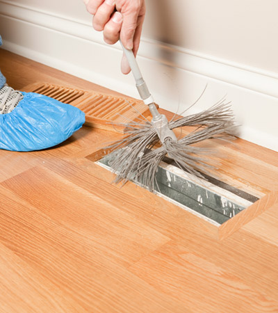 Cleaning an indoor air duct register at home