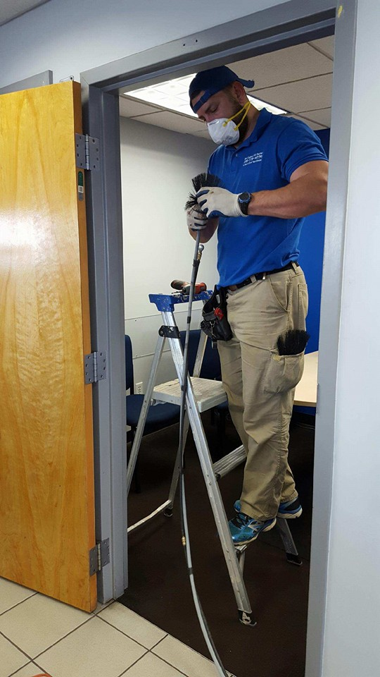 Cleaning out vents to make sure office buildings run efficently