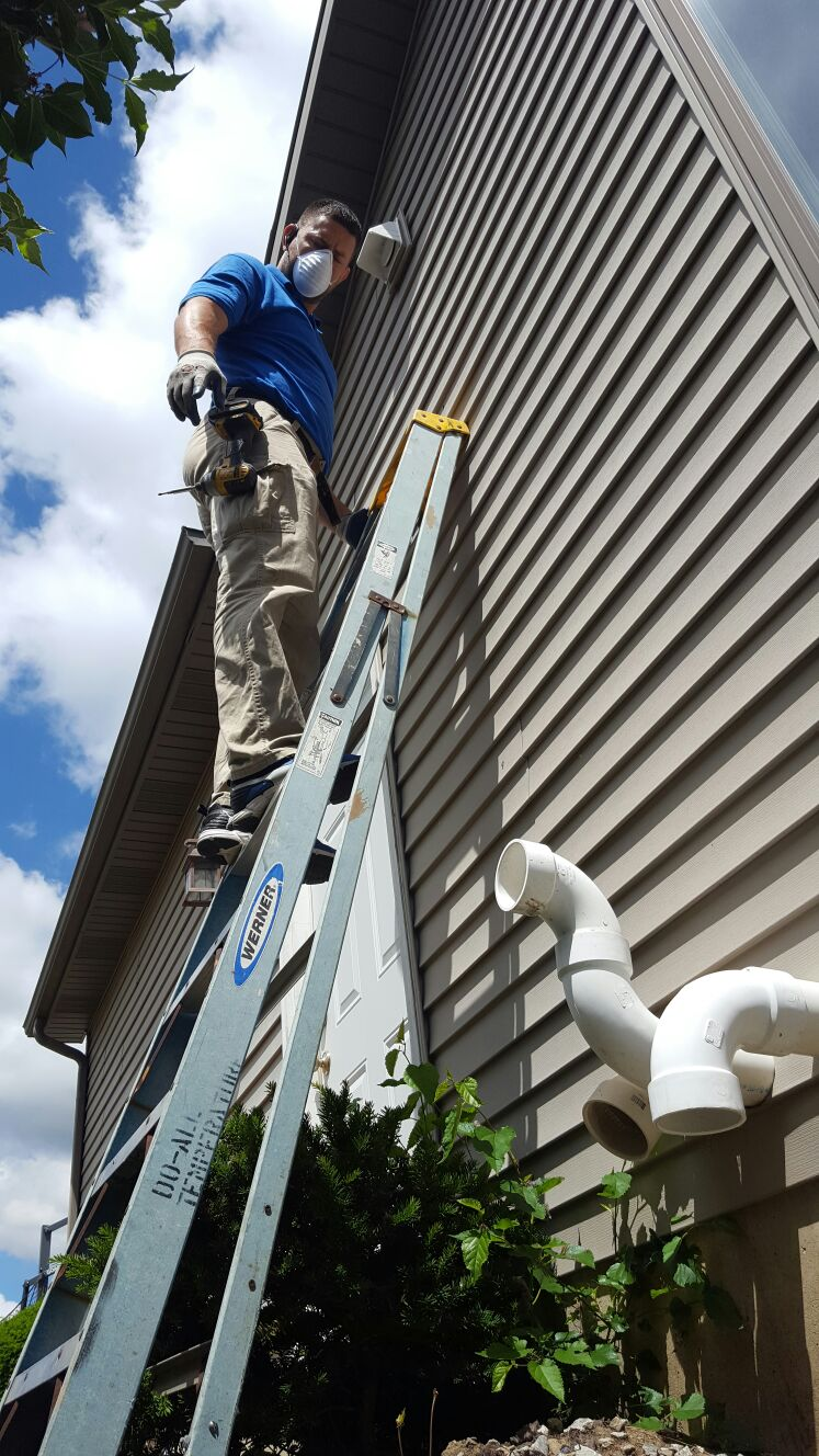 Using a ladder to climb to places to remove dust from air ducts.