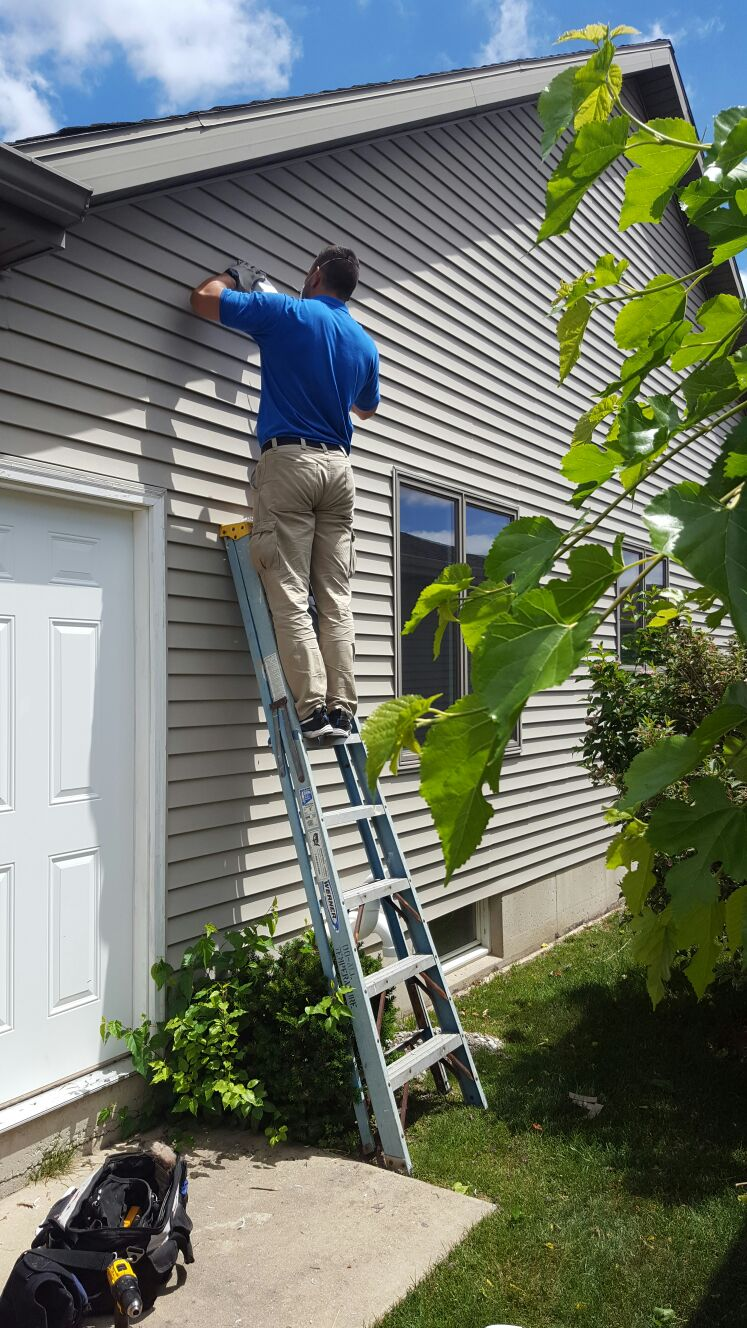 Using a ladder to reach air ducts