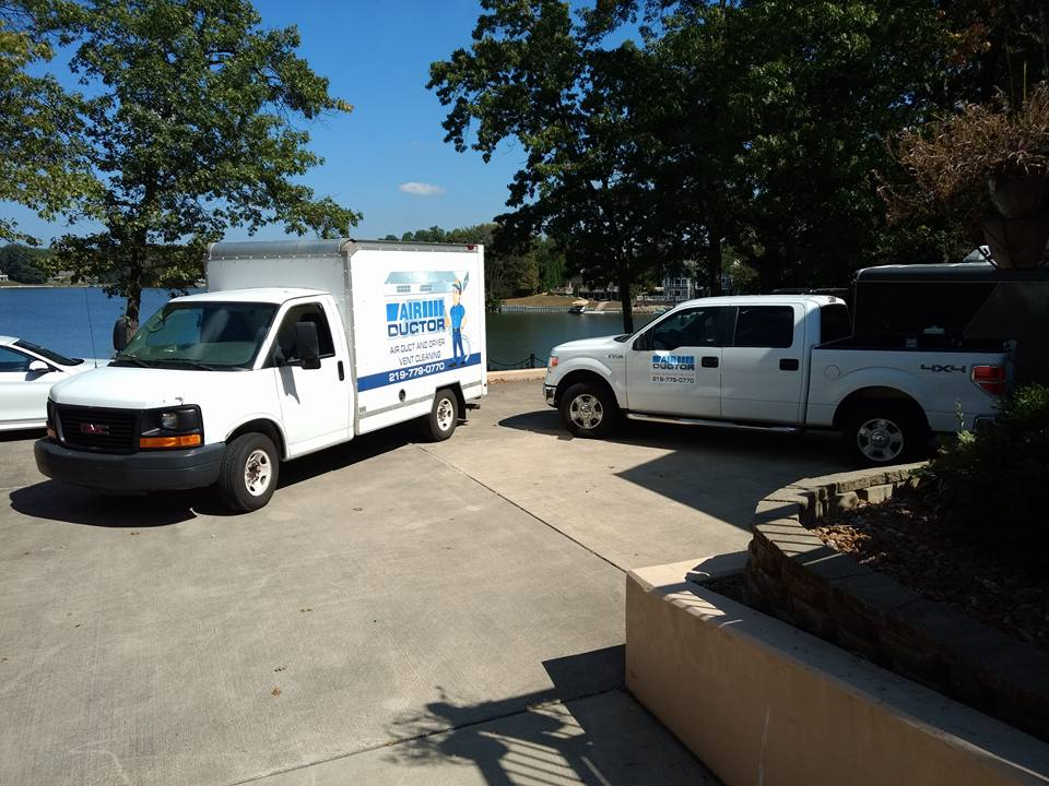Air Ductors trucks parked to do a air duct cleaning job.